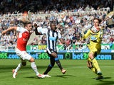 Newcastle United's Dutch goalkeeper Tim Krul (R) makes a save from Arsenal's French striker Olivier Giroud (L) during the English Premier League football match between Newcastle United and Arsenal at St James' Park in Newcastle-upon-Tyne, north east Engla