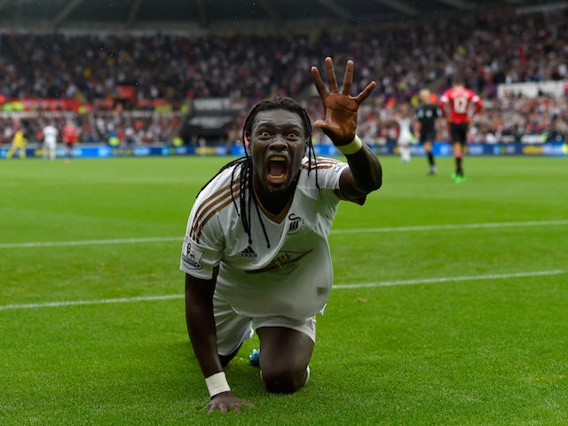 Swansea striker Bafetimbi Gomis celebrates after scoring the second swansea goal during the Barclays Premier League match between Swansea City and Manchester United on August 30, 2015