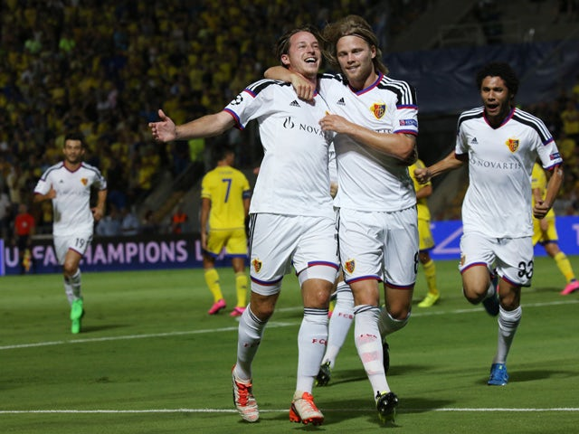 Basel's players celebrate after scoring their first goal during the UEFA Champions League playoff football match second leg between FC Basel and Maccabi Tel Aviv at the Bloomfield Stadium in Tel Aviv on August 25, 2015