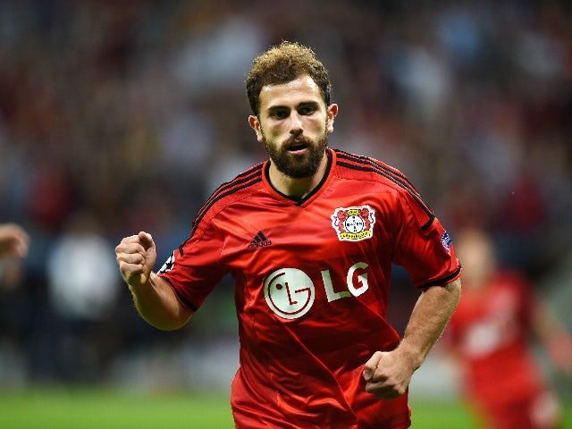Leverkusen's Swiss forward Admir Mehmedi celebrates scoring during the UEFA Champions League playoff football match between Bayer Leverkusen and SS Lazio, in Leverkusen, western Germany, on August 26, 2015.
