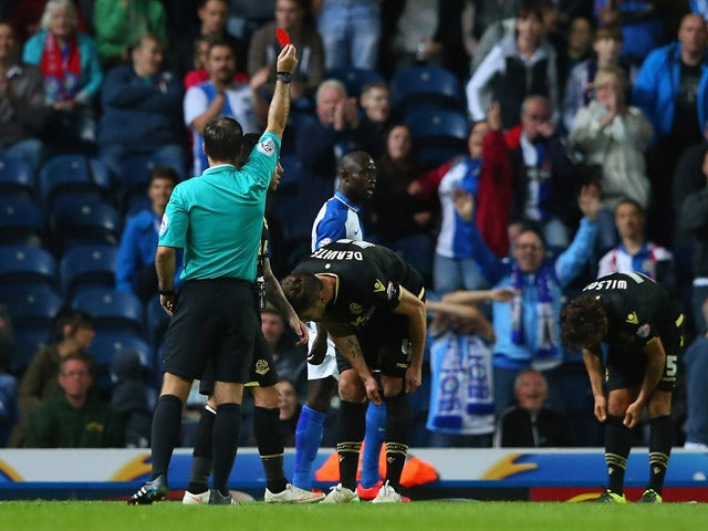 Dorian Dervite of Bolton Wanderers is sent off by referee Paul Tierney during the Sky Bet Championship match between Blackburn Rovers and Bolton Wanderers at Ewood park on August 28, 2015
