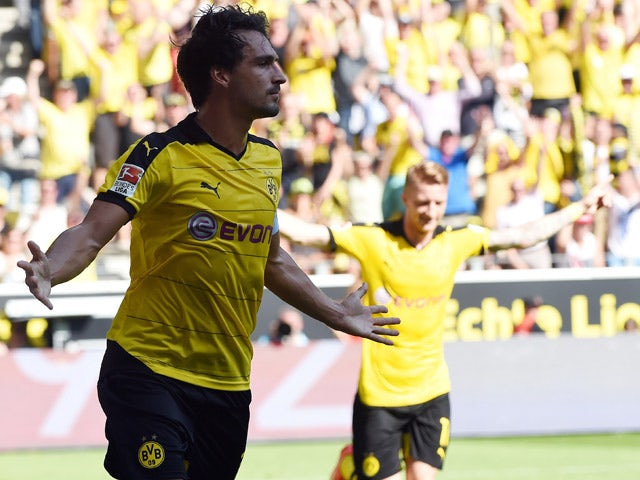 Dortmund's defender Mats Hummels celebrates after scoring a goal during the German first division Bundesliga football match Borussia Dortmund vs Hertha BSC in Dortmund, Germany, on August 30, 2015