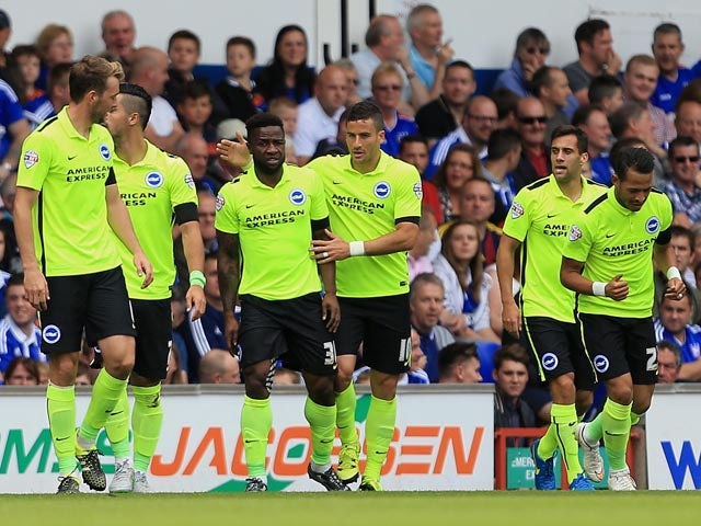 Kazenga Lualua of Brighton celebrates his opening goal with Tomer Hemed of Brighton during the Sky Bet Championship match between Ipswich Town and Brighton and Hove Albion at Portman Road stadium on August 29, 2015