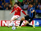 Wayne Rooney of Manchester United takes on Oscar Duarte of Club Brugge during the UEFA Champions League qualifying round play off 2nd leg match between Club Brugge and Manchester United held at Jan Breydel Stadium on August 26, 2015 in Brugge, Belgium.