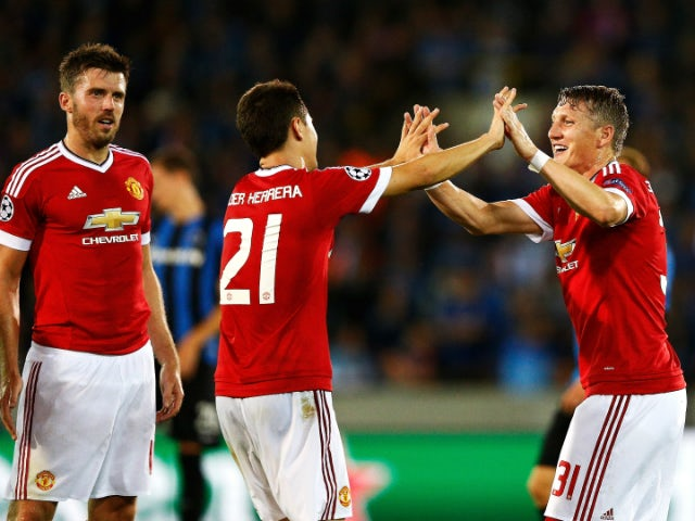 Ander Herrera of Manchester United celebrates scoring his team's fourth goal with Bastian Schweinsteiger of Manchester United during the UEFA Champions League qualifying round play off 2nd leg match between Club Brugge and Manchester United held at Jan Br
