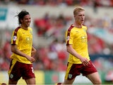 Ben Mee of Burnley celebrates scoring the opening goal with George Boyd during the Sky Bet Championship match between Bristol City and Burnley at Ashton Gate on August 29, 2015