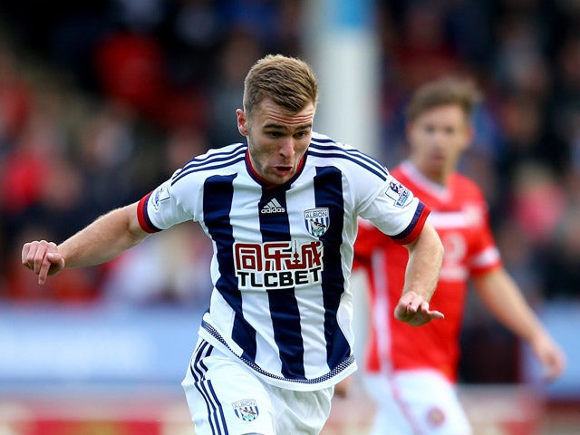 Callum McManaman of West Brom in action during the Pre-Season Friendly between Walsall and West Bromwich Albion at Banks' Stadium on July 28, 2015
