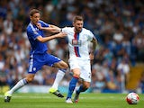 Connor Wickham of Crystal Palace and Nemanja Matic of Chelsea compete for the ball during the Barclays Premier League match between Chelsea and Crystal Palace at Stamford Bridge on August 29, 2015