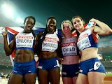 Christine Ohuruogu of Great Britain, Anyika Onuora of Great Britain, Eilidh Child of Great Britain and Seren Bundy-Davies of Great Britain celebrate after winning bronze in the Women's 4x400 Relay Final during day nine of the 15th IAAF World Athletics Cha