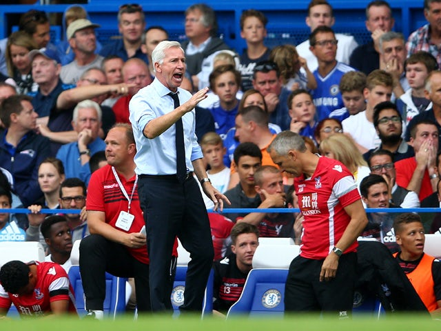 Alan Pardew Manager of Crystal Palace gestures in the Barclays Premier League match between Chelsea and Crystal Palace at Stamford Bridge on August 29, 2015