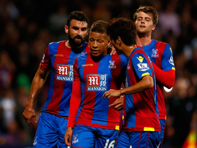 Dwight Gayle of Crystal Palace (c) is congratulated by his team mates after scoring his side's first goal from the penatly spot during the Capital One Cup second round match between Crystal Palace and Shrewsbury Town at Selhurst Park on August 25, 2015