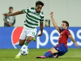 CSKA Moscow's midfielder from Serbia Zoran Tosic (R) vies with Sporting's midfielder Andre Carrillo (L) during the UEFA Champions League play-offs, second leg football match between CSKA Moscow and Sporting CP, at the Khimki Arena outside Moscow on August