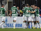 Sporting's players celebrate a goal during the UEFA Champions League play-offs, second leg football match between CSKA Moscow and Sporting CP, at the Khimki Arena outside Moscow on August 26, 2015.