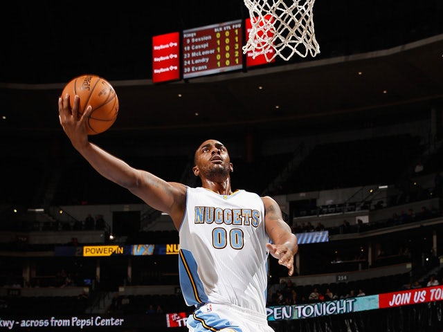 Darrell Arthur #00 of the Denver Nuggets lays up a shot against the Sacramento Kings at Pepsi Center on November 3, 2014