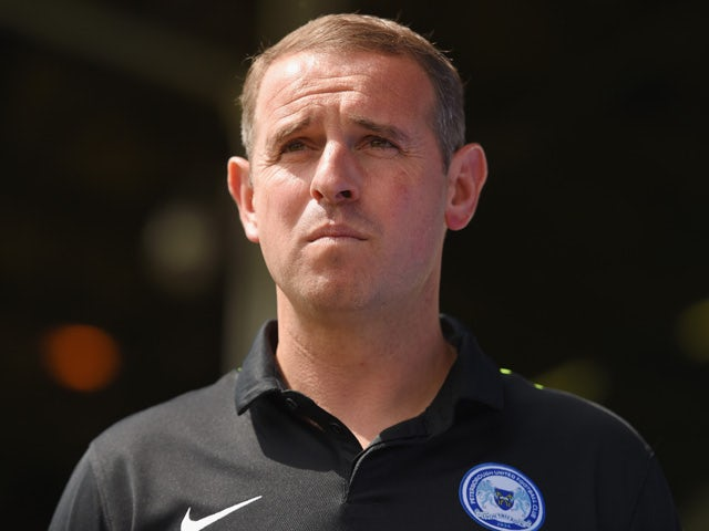 Peterborough United manager Dave Robertson looks on during the pre season friendly match between Peterborough United and a Tottenham Hotspur XI at London Road Stadium on July 18, 2015