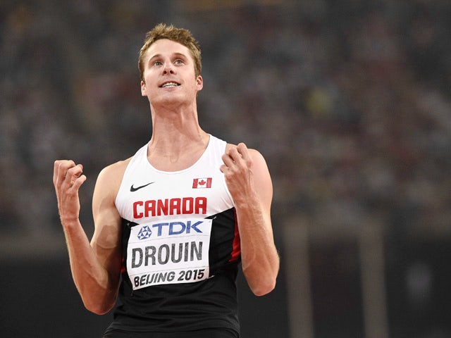 Canada's Derek Drouin reacts in the final of the men's high jump athletics event at the 2015 IAAF World Championships at the 'Bird's Nest' National Stadium in Beijing on August 30, 201
