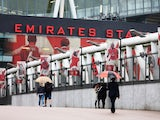 Fans begin to arrive at a rainy Emirates ahead of Arsenal's clash with Liverpool on August 24, 2015