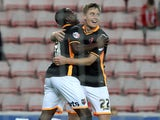 Exeter City's English midfielder David Wheeler celebrates with Exeter City's English midfielder Manny Oyeleke (L) after scoring their second goal during the English League Cup second round football match between between Sunderland and Exeter City at the S