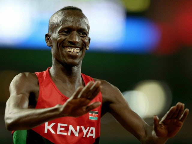 BEIJING, CHINA - AUGUST 24: Ezekiel Kemboi of Kenya celebrates after winning gold in the Men's 3000 metres steeplechase final during day three of the 15th IAAF World Athletics Championships Beijing 2015 at Beijing National Stadium on August 24, 2015 in Be