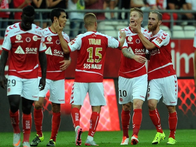 Reims' Gaëtan Charbonnier (2ndR) is congratulated by teammates after scoring a goal during the French L1 football match between Reims and Lorient on August 31, 2015