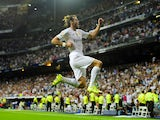Real Madrid's Welsh forward Gareth Bale celebrates after scoring his second goal during the Spanish league football match Real Madrid CF vs Real Betis Balompie at the Santiago Bernabeu stadium in Madrid on August 29, 2015
