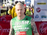 Iwan Thomas poses for photographs ahead of the Virgin London Marathon on April 21, 2013