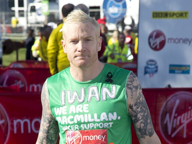 Iwan Thomas poses for photographs ahead of the Virgin London Marathon on April 21, 2013