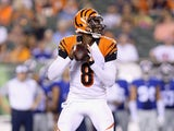 Josh Johnson #8 of the Cincinnati Bengals prepares to pass the ball against the New York Giants during an preseason game at Paul Brown Stadium on August 14, 2015