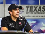 Andretti Autosport driver Justin Wilson answers questions during an interview after the Speeding to Read championship assembly at Texas Motor Speedway on May 19, 2015