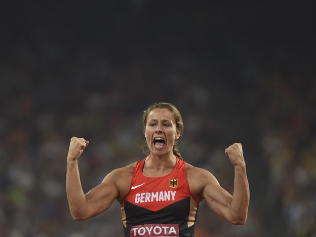 Germany's Kathrina Molitor reacts in the final of the women's javelin throw athletics event at the 2015 IAAF World Championships at the 'Bird's Nest' National Stadium in Beijing on August 30, 2015