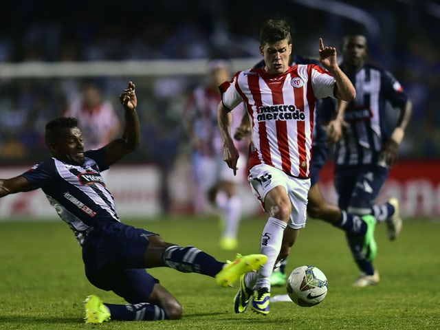 Uruguay's River Plate Leandro Rodriguez vies for the ball with Ecuador's Emelec Gabriel Achilier during their Copa Sudamericana football match at George Capwell stadium in Guayaquil, Ecuador, on September 18, 2014
