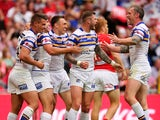 Leeds Rhinos celebrate after scoring a try during the Ladbrokes Challenge Cup Final between Leeds Rhinos and Hull KR at Wembley Stadium on August 29, 2015