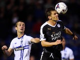 Dean Hammond of Leicester City wins a header with Danny Pugh of Bury during the Capital One Cup second round match between Bury and Leicester City at Gigg Lane on August 25, 2015