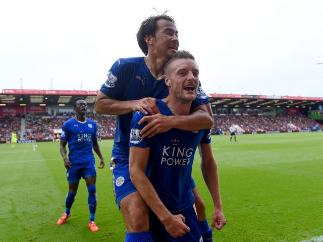 Jamie Vardy of Leicester City celebrates scoring his team's first goal with his team mate Shinji Okazaki during the Barclays Premier League match between A.F.C. Bournemouth and Leicester City at Vitality Stadium on August 29, 2015