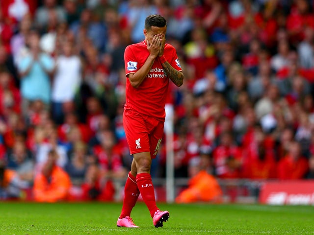 Philippe Coutinho of Liverpool walks off the pitch after receiving a red card during the Barclays Premier League match between Liverpool and West Ham United at Anfield on August 29, 2015