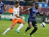 Troyes' French midfielder Lossemy Karaboue (R) vies with Montpellier's French midfielder Paul Lasne (L) during the French L1 football match between Troyes and Montpellier on August 29, 2015