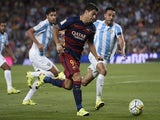Barcelona's Uruguayan forward Luis Suarez (C) vies with Malaga's Brazilian defender Weligton during the Spanish league football match FC Barcelona vs Malaga CF at the Camp Nou stadium in Barcelona on August 29, 2015