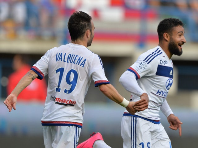 Lyon's French midfielder Nabil Fekir is congratulated by his teammate Mathieu Valbuena during the French L1 football match between Caen (SM Caen) and Olympique Lyonnais, on August 29, 2015