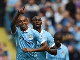 Manchester City's Brazilian midfielder Fernandinho (L) celebrates after scoring his team's second goal during the English Premier League football match between Manchester City and Watford at The Etihad Stadium in Manchester, north west England on August 2