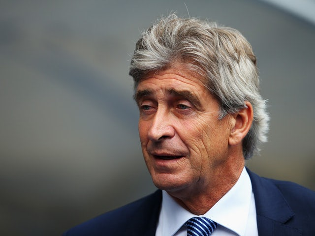 Manuel Pellegrini, manager of Manchester City looks on during the Barclays Premier League match between Manchester City and Watford at Etihad Stadium on August 29, 2015