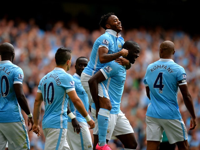 Raheem Sterling of Manchester City celebrates scoring his team's first goal with his team mates during the Barclays Premier League match between Manchester City and Watford at Etihad Stadium on August 29, 2015