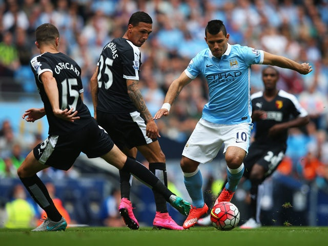 Sergio Aguero (R) of Manchester City competes against Craig Cathcart (L) and Jose Holebas (C) of Watford during the Barclays Premier League match between Manchester City and Watford at Etihad Stadium on August 29, 2015