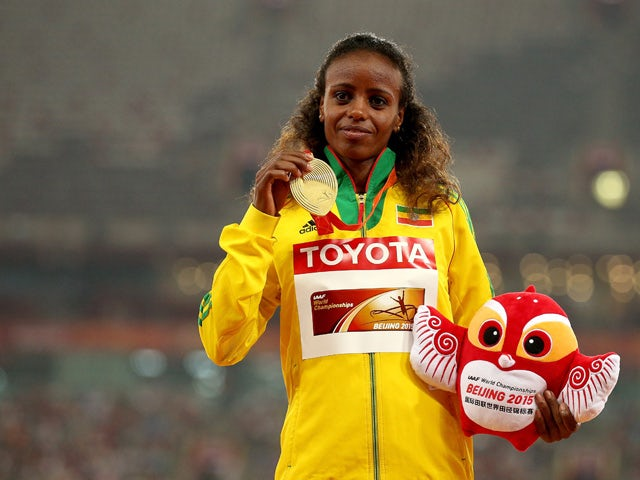 Gold medalist Mare Dibaba of Ethiopia poses on the podium during the medal ceremony for the Women's Marathon final during day nine of the 15th IAAF World Athletics Championships Beijing 2015 at Beijing National Stadium on August 30, 2015