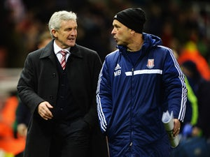 Stoke City manager Mark Hughes and his assistant Mark Bowen talk at the end of the Budweiser FA Cup third round match between Stoke City and Leicester City at the Britannia Stadium on January 4, 2014