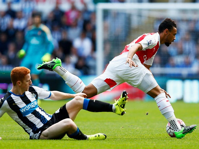 Francis Coquelin of Arsenal is tackled by Jack Colback of Newcastle United during the Barclays Premier League match between Newcastle United and Arsenal at St James' Park on August 29, 2015