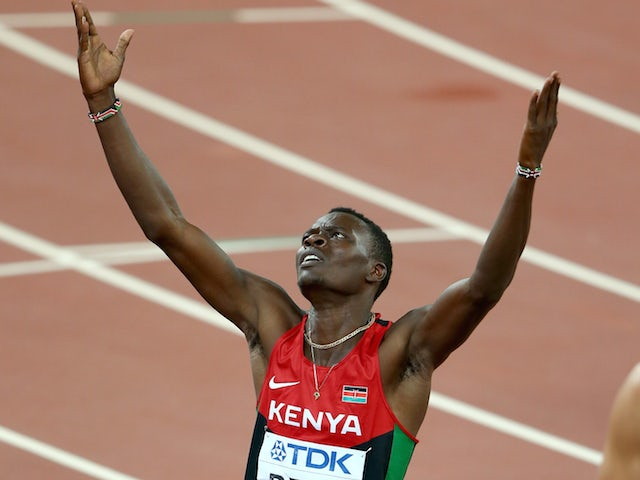 Nicholas Bett raises his hands to the sky after winning gold for Kenya in the men's 400m hurdles at the World Championships on August 25, 2015