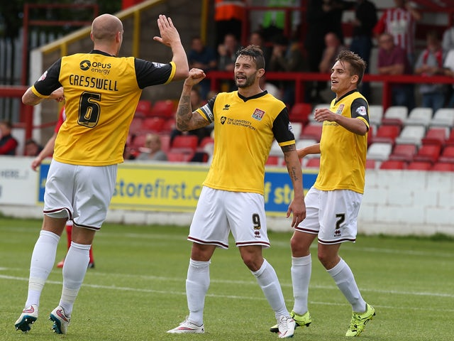 Marc Richards of Northampton Town is congratulated by team mates Ryan Cresswell and Lawson D'Ath after scoring his sides 1st goal during the Sky Bet League Two match between Accrington Stanley and Northampton Town at The Wham Stadium on August 29, 2015