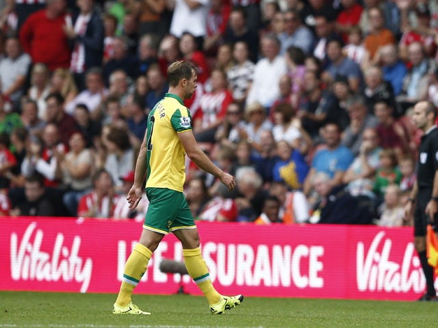 Norwich City's Scottish defender Steven Whittaker walks from the pitch after receiving a red card during the English Premier League football match between Southampton and Norwich City at St Mary's Stadium in Southampton, southern England on August 30, 201