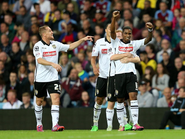 Genaro Snijders (R) of Notts County celebrates scoring the opening goal with team mates during the Capital One Cup second round match between Aston Villa and Notts County at Villa Park on August 25, 2015