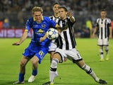 Aleksandr Hleb (L) of BATE in action against Darko Brasanac (R) of Partizan Belgrade during the UEFA Champions League Qualifying Round Play Off Second Leg match between Partizan Belgrade and BATE at Partizan stadium on August 26, 2015 in Belgrade, Serbia